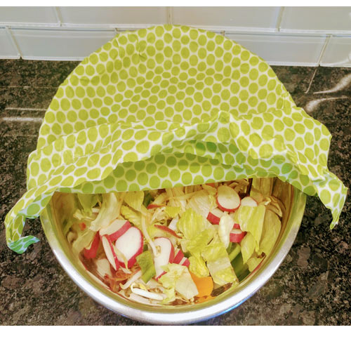 Beezy Wrap beeswax food wraps. A Beezy Wrap beeswax food wrap used as a lunch wrap to cover your salad. Bee Wrap will keep your food fresh longer. Made in Nova Scotia, Canada.